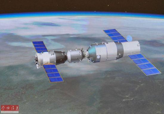 資料圖片:神舟十號與天宮一號自動交會對接成功的模擬畫面。