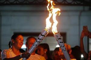 奥运圣火即将抵达里约 火炬手包括清洁工等普通人
