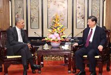 习近平会见美国前总统奥巴马