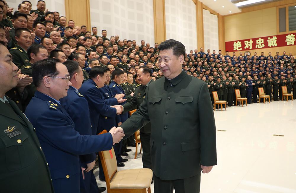 全军坚决拥护中央关于修改宪法部分内容的建议图片