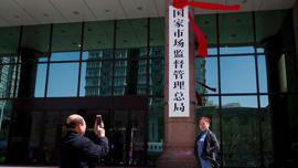北京观察:机构改革分工调整应对贸易战